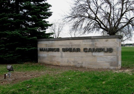 Stone sign reading, &#34Maurice Spear Campus.&#34