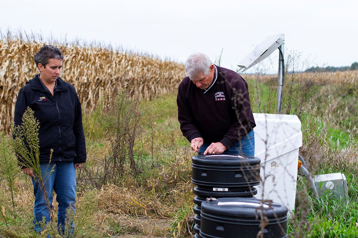 garrison and van wagner check the gates on a drainage system in Lenawee
